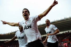 Manchester United's van Persie celebrates after scoring a hat-trick against Southampton during their English Premier League soccer match at Saint Mary's Stadium in Southampton